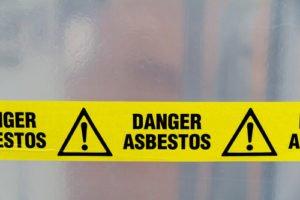 Danger Asbestos Written on Yellow Tape
